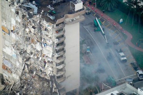 Rescue workers searching in the rubble at the Champlain Towers South Condo on Saturday.