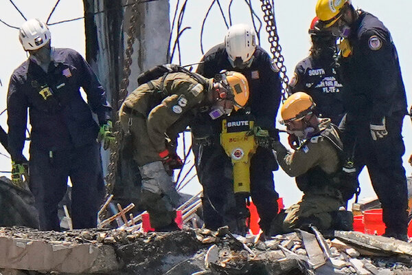 Two members of an Israeli rescue team working with American crews in the rubble at the Champlain Towers South Condo last month.