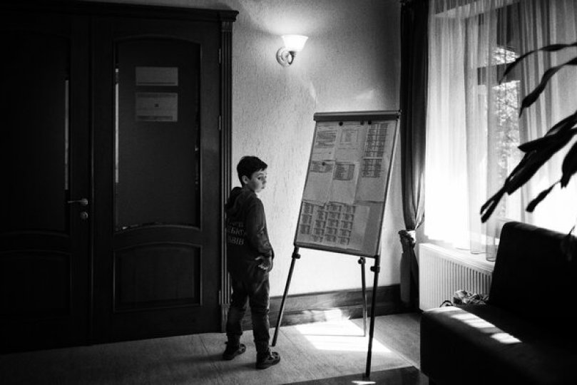 A young chess player looking at scores and tournament standings at a tournament in Ukraine.