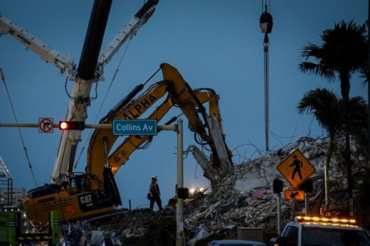 The rescue work continued after dark on Tuesday at the collapse site in Surfside, Fla.