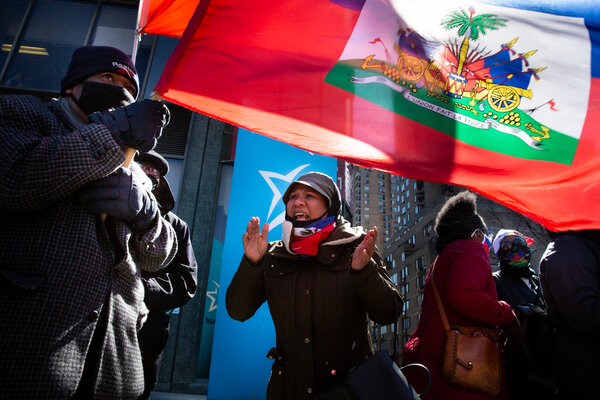 Members of Montreal's Haitian diaspora holding an anti-Moïse demonstration outside the Haitian consulate in March.