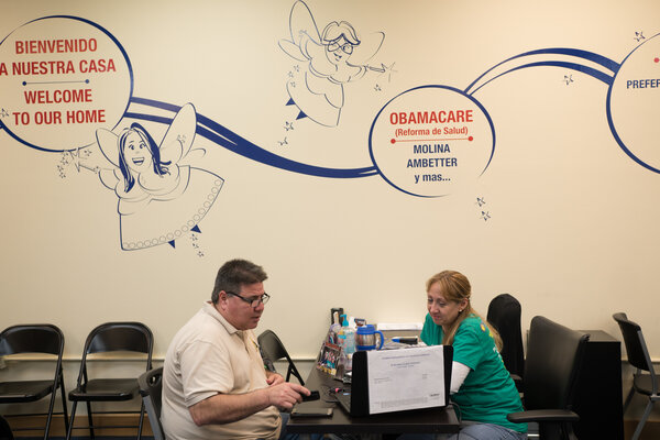 A man signing up for health insurance through the Affordable Care Act in Miami in 2016. Marketplace enrollments are at a record high, after President Biden re-opened enrollment in February and Congress acted to lower the cost.