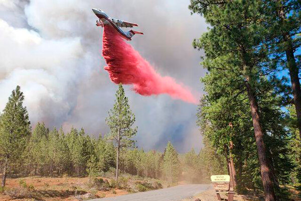 A tanker drops retardant over the Mitchell Monument area last week.