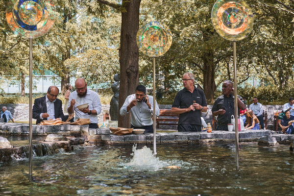 Workers ate lunch at Jubilee Park in London on Monday, the day that Britain loosened all its remaining coronavirus restrictions.