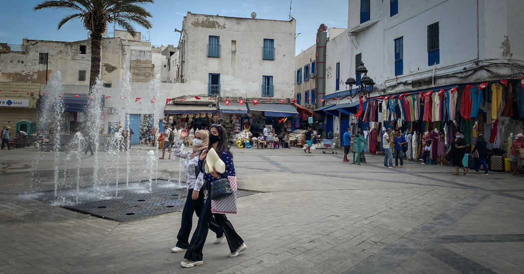 With Gatherings Banned Amid Turmoil, Tunisians Can Only Watch. And Wait.