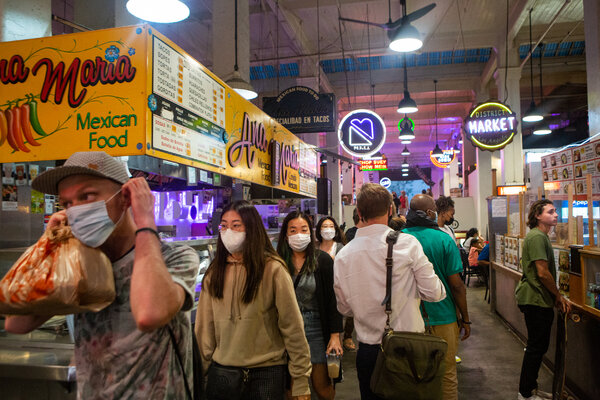 Patrons in Grand Central Market in Los Angeles wore masks on Tuesday. California's Department of Public Health recommended on Wednesday that people wear masks indoors regardless of vaccination status.