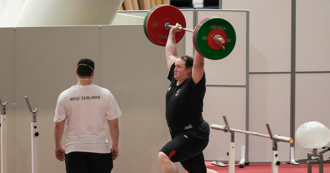 A transgender weight lifter's presence at the Games prompts discussions over inclusion and fairness.