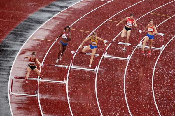 Anna Cockrell, second from left, running in a women's 400-meter hurdles semifinal heat.