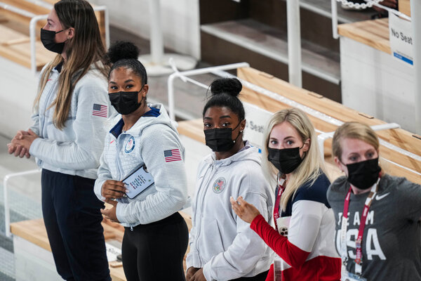 Simone Biles, center, said she would compete on Tuesday.