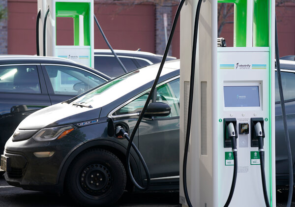 Electric vehicles at a charging station in Lakewood, Colo.