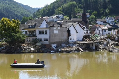 Military personnel inspectedby boat the area across the Ahr river in Rech, Rhineland-Palatinate, in western Germany, after devastating floods hit the region last month.