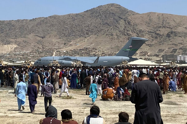 A crowd gathered near a U.S. Air Force C-17 transport plane at Kabul's international airport on Monday.