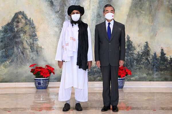 China's foreign minister, Wang Yi, right, with the Taliban co-founder Mullah Abdul Ghani Baradar, during a meeting in Tianjin in July.