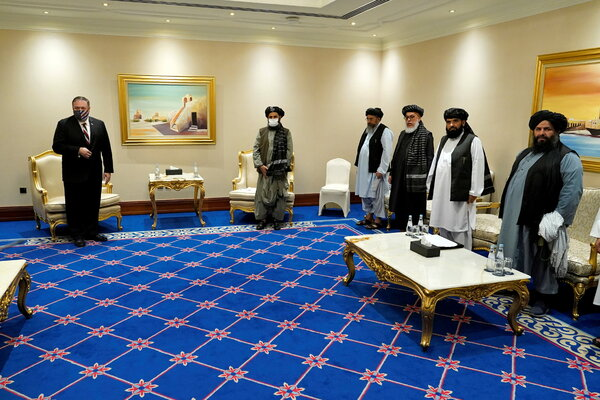Mike Pompeo, thenSecretary of State, meeting with the Taliban leader Mullah Abdul Ghani Baradar and Taliban peace negotiators in Doha, Qatar, in November 2020.
