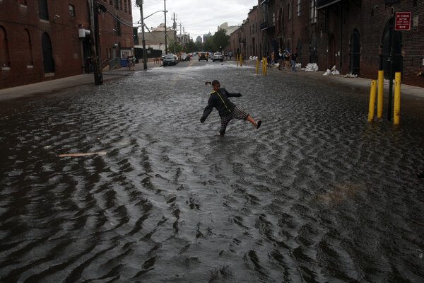 Flooded streets in Brooklyn from rain dropped by Hurricane Irene in 2011.