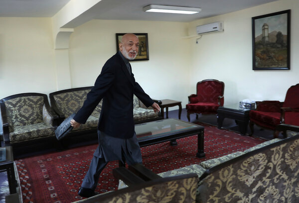 Former President Hamid Karzai leaving after an interview at his house in Kabul, Afghanistan, in June.