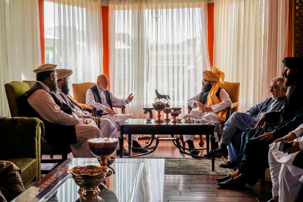In a photograph released by the Taliban, former President Hamid Karzai, center left, met in Kabul last week with  Abdullah Abdullah, second from right, and a  Taliban delegation including Anas Haqqani, center right.