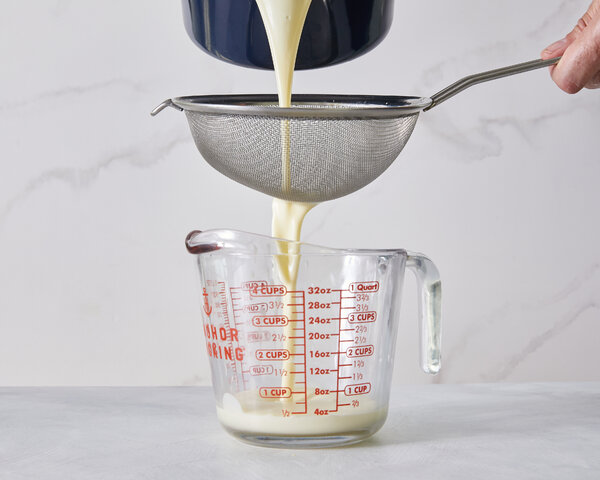 A heated cream is poured into a lemony mixture, then let to sit in the fridge.
