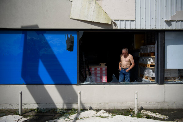 TroyBonvillian looked at the damage to his flooring business in Houma, La., on Monday.