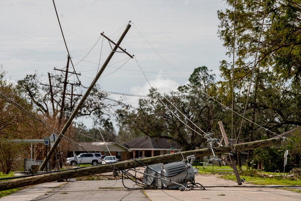 Power lines and utility poles blocked a road in Houma, La., on Tuesday.