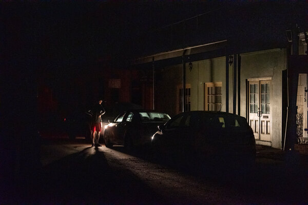 The streets of New Orleans were dark Monday night as much of the city remains without power.