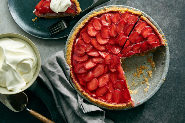 A layer of strawberry slices tops a creamy strawberry mousse in this pie, which is then covered by gelatin for a triple whammy of summer flavor.