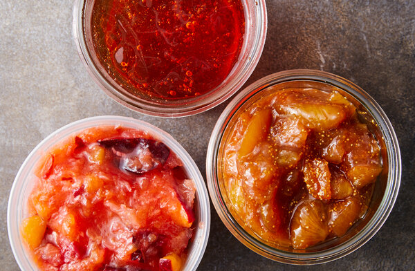 A variety of delicious preserves capture memories of farm visits, perfect produce and summer sunshine in small glass jars.
