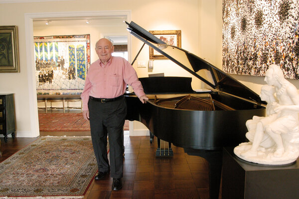 """Mr. Wein at his home in 2004, the year the Newport Jazz Festival celebrated its 50th anniversary. He knew from an early age, he said, that """"music was a crucial part of my being,"""" but he also knew that he """"had neither the confidence nor the desire to devote my life to being a professional jazz musician."""""""