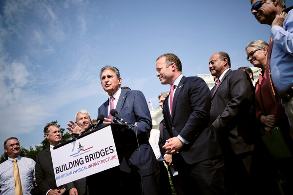 Senator Joe Manchin III of West Virginia promoted the infrastructure bill alongside a bipartisan group of lawmakers at the Capitol in July.