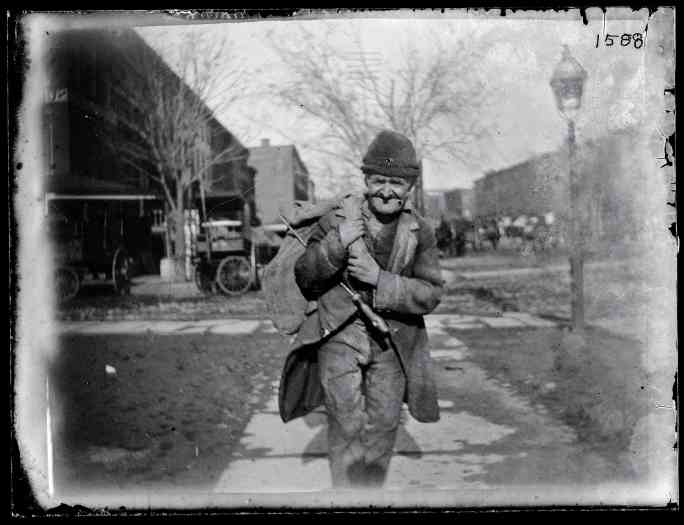 A man walking in Brooklyn, circa 1872-1887.