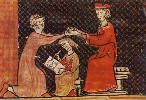 A kneeling vassal performs the inmixtio manum during the homage to his seated lord.