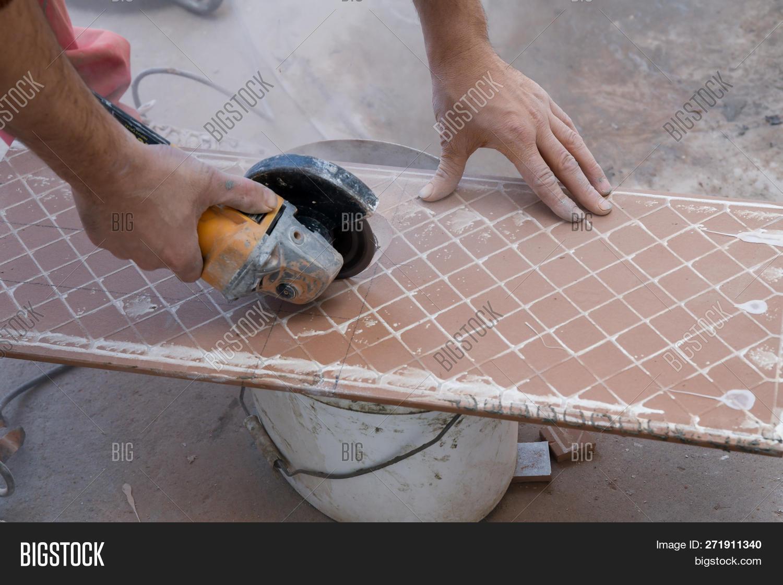 cutting ceramic tiles image photo