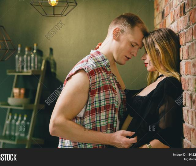 Young Passionate Couple During Foreplay In The Kitchen