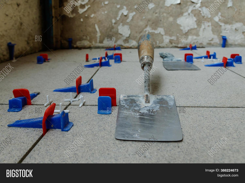 tile leveling system image photo