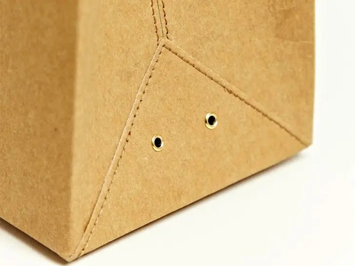 Note the eyelets. All your paper bag ventilation problems are now solved.