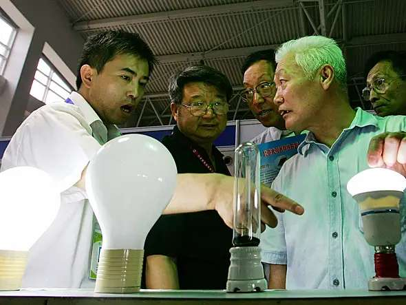 China makes more than 16 times as many energy saving lamps per person than the rest of the world.