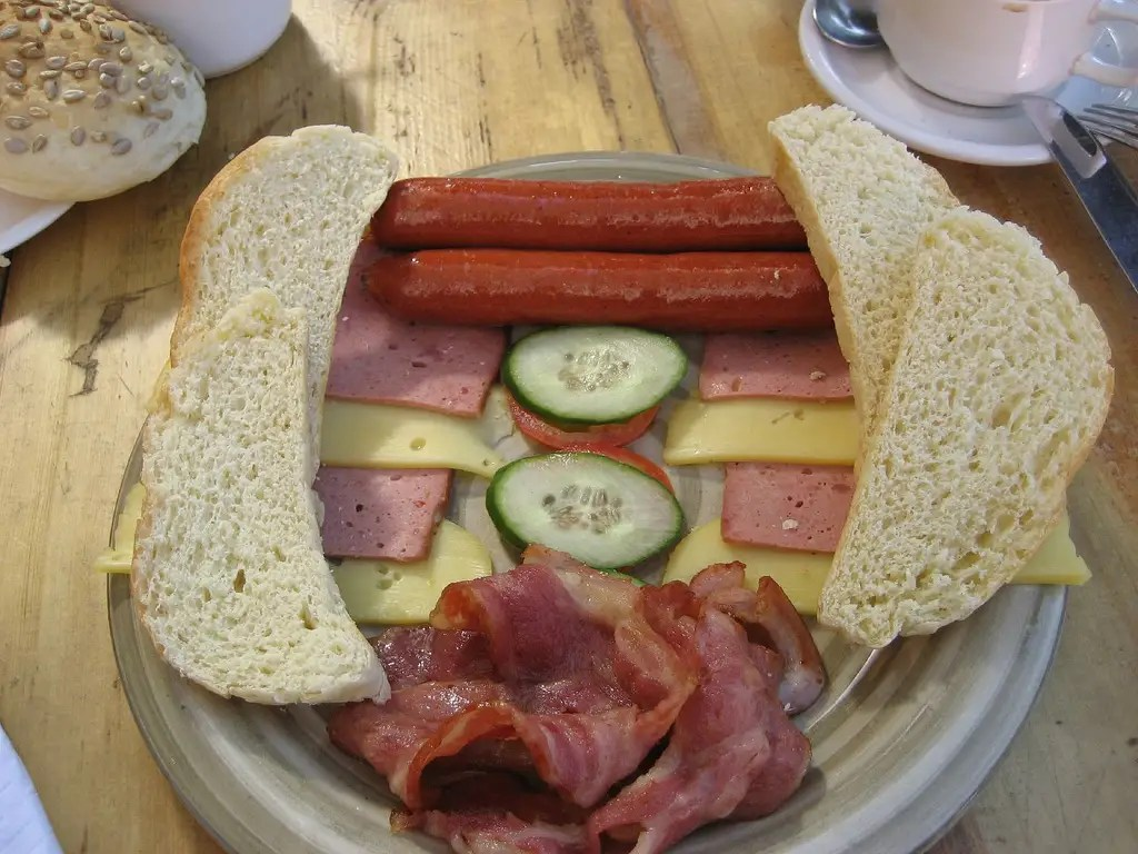 GERMANY: A typical breakfast includes cold meats, including sausages, local cheeses, and fresh baked bread.