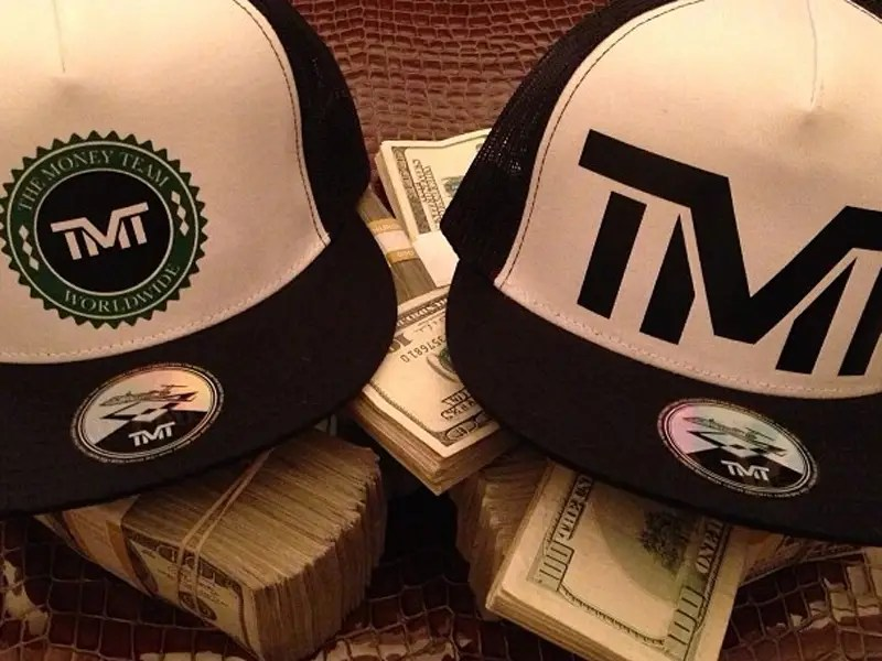 "He promoted his ""The Money Team"" line of hats by putting them on stacks of $10,000 in cash."