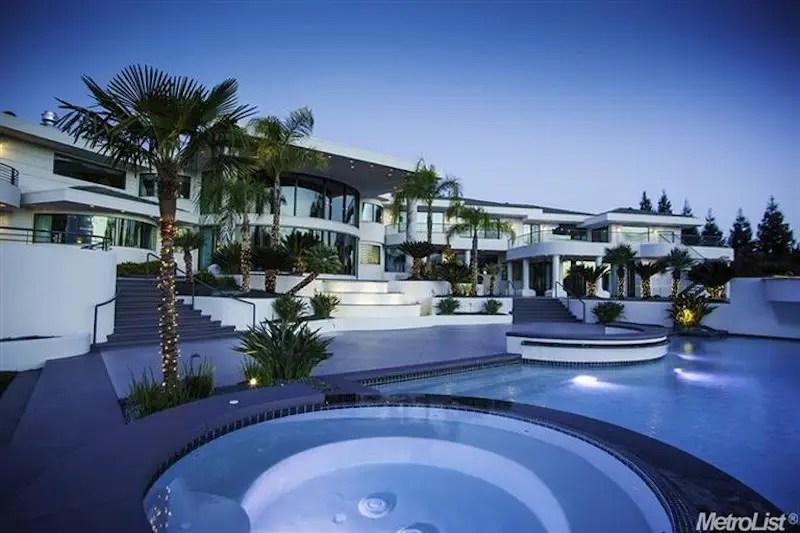 The mansion and its pool look even bigger from the backyard.