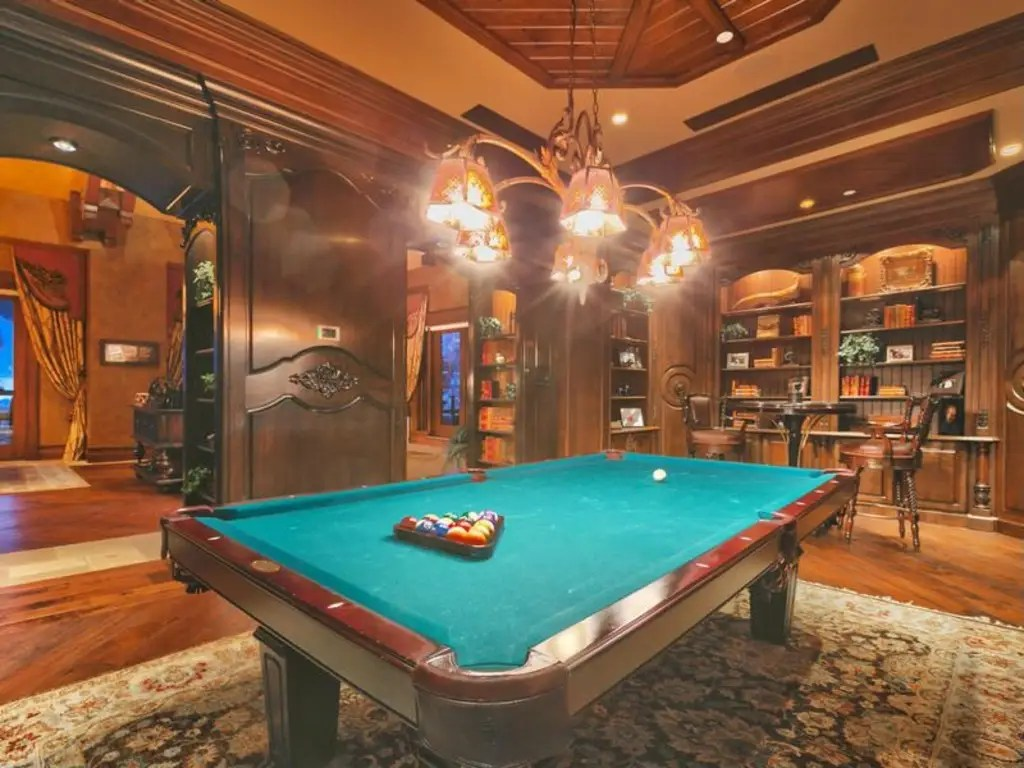 A pool table in the game room.