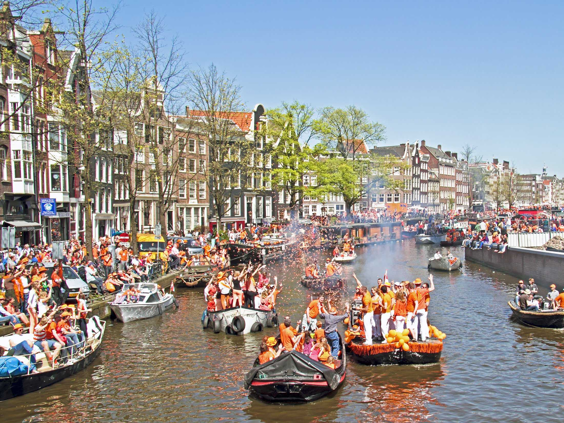 Toast to the royalty of Amsterdam on Queen's Day, when people dress in orange and party all night in The Netherlands' capital.