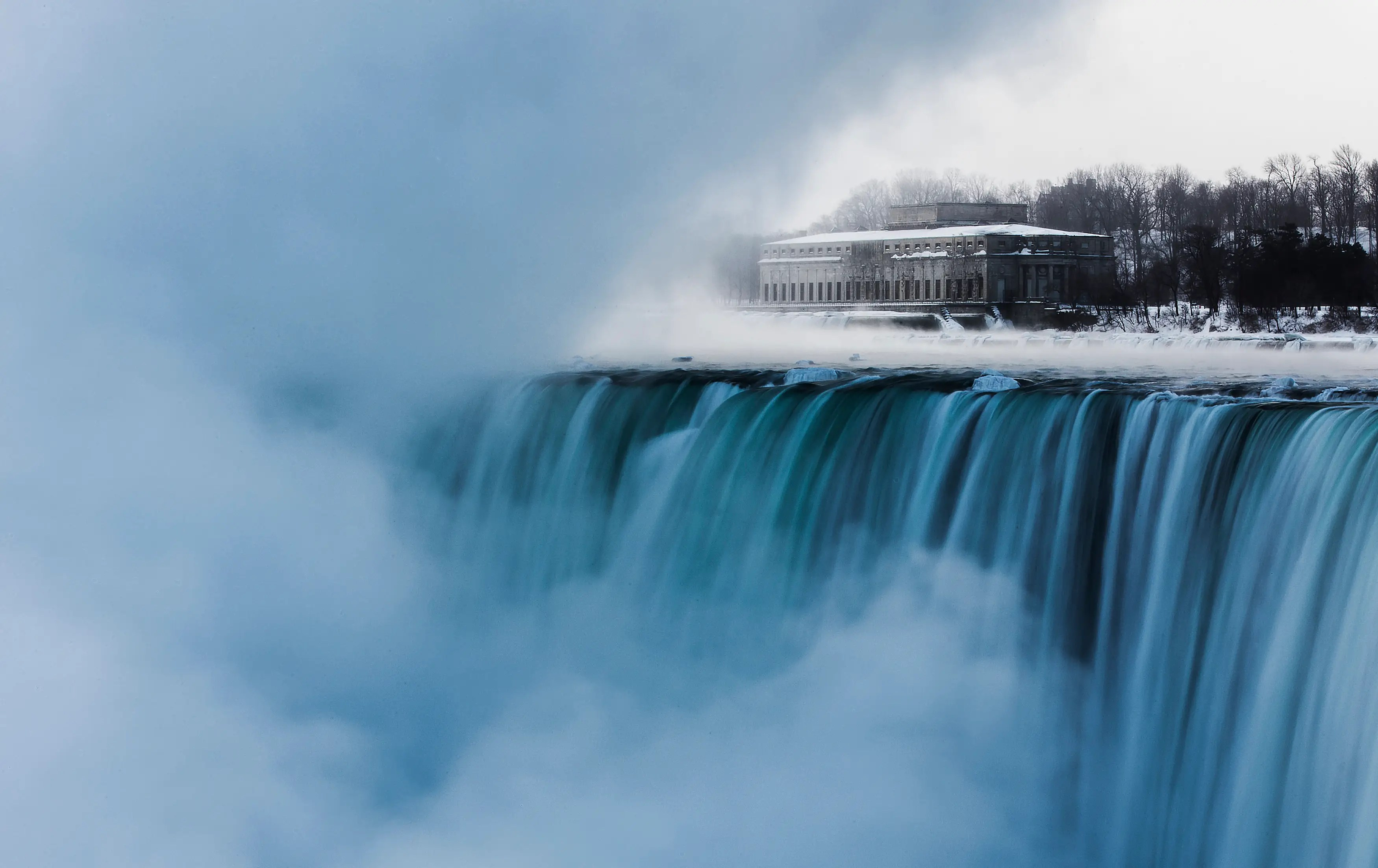 An old hydro building is seen behind Niagara Falls during sub-freezing temperatures in Niagara Falls, Ontario.