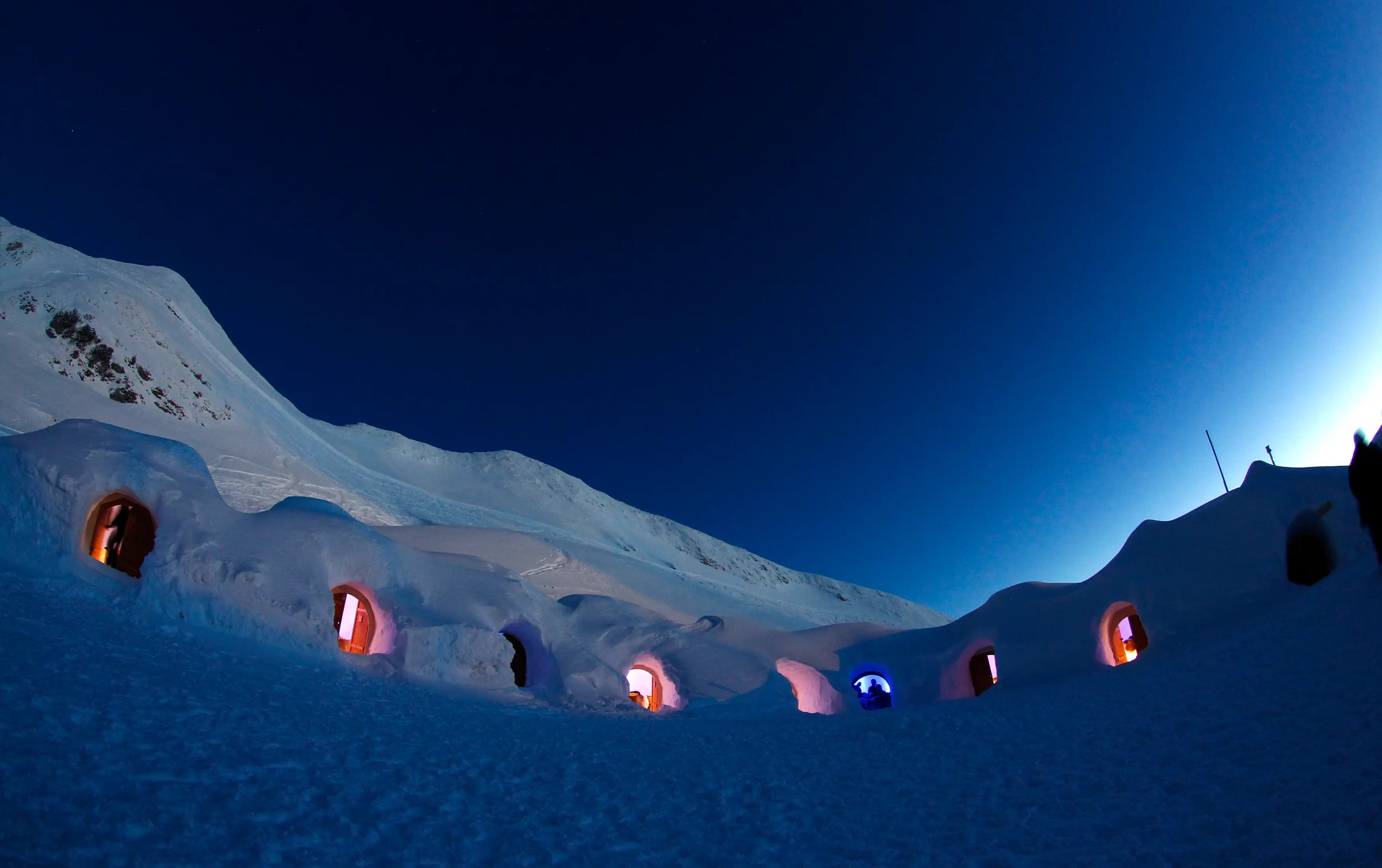 Dimmed lights are switched on in igloos on top of the mountain Nebelhorn, near the southern Bavarian town of Oberstdorf.