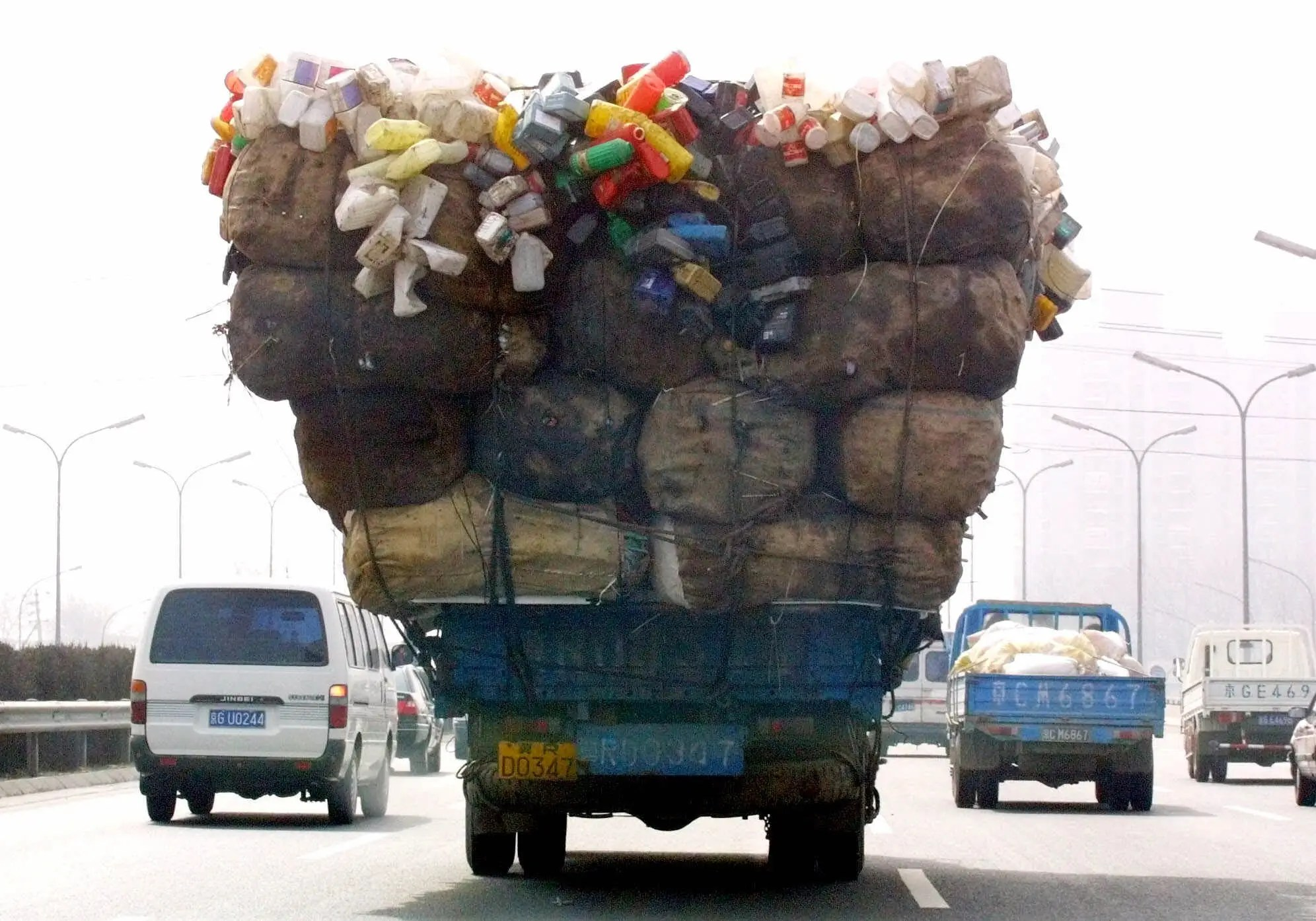 Here's a Chinese truck carry a wide load down a road.