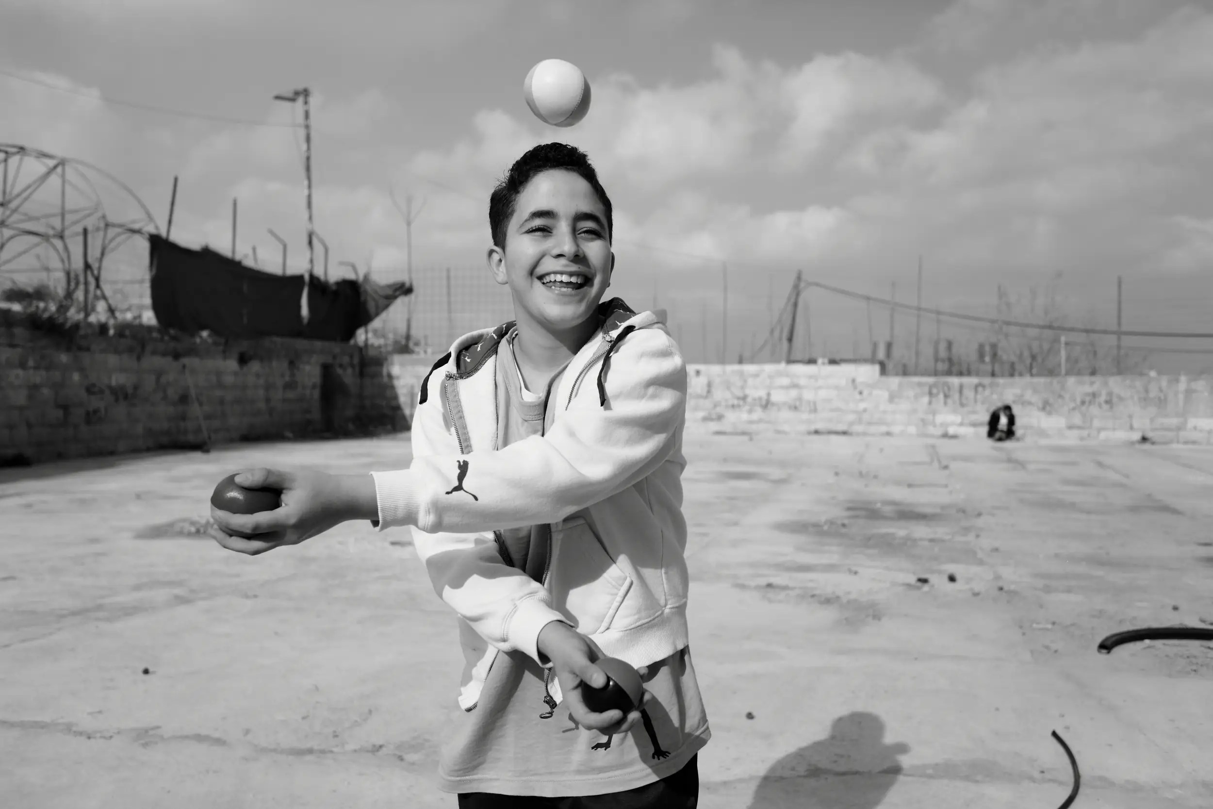 The Palestinian Circus School was established in 2009 in the village of Birzeit. Here, a Palestinian child practices at the school.