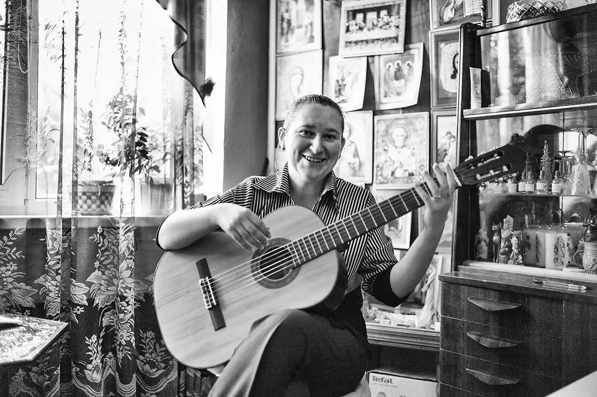 """Anna, age 29. Profession: Musician. Passion or Dream: """"I love singing and performing — my solo concerts, playing the guitar, psychology, philosophy, traveling and studying other cultures and religions."""""""