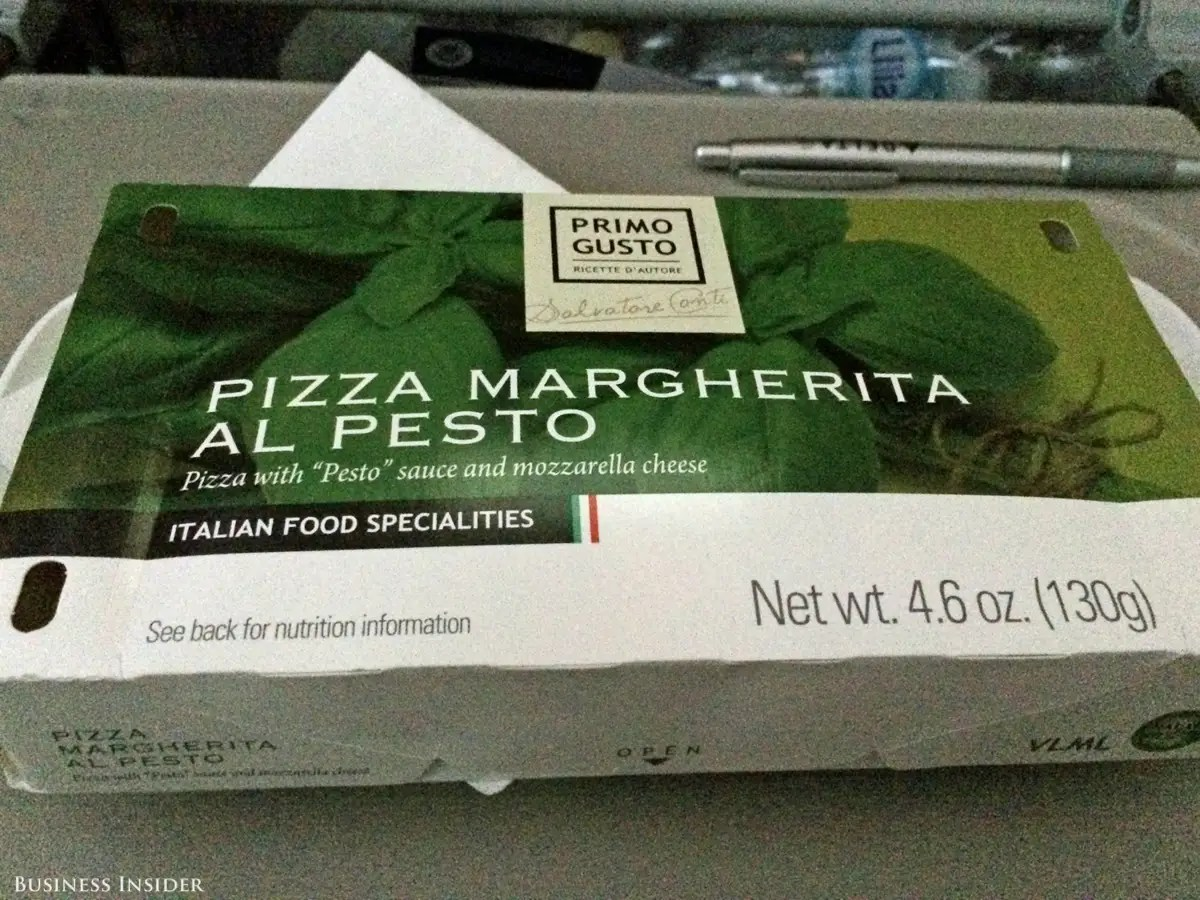 "Shortly before we landed, the flight attendants handed out our ""snack"" — ""pizza margherita al pesto."" I had high expectations ..."