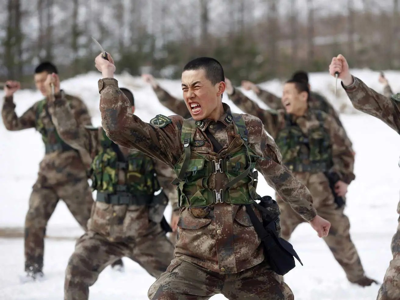 People's Liberation Army (PLA) soldiers shout as they practise with knives during a training session on snow-covered ground at a military base in Heihe, Heilongjiang province March 18, 2015.  Read more: http://www.businessinsider.com/china-just-revealed-a-terrifying-new-cyberweapon-2015-4#ixzz3X80CjiUE