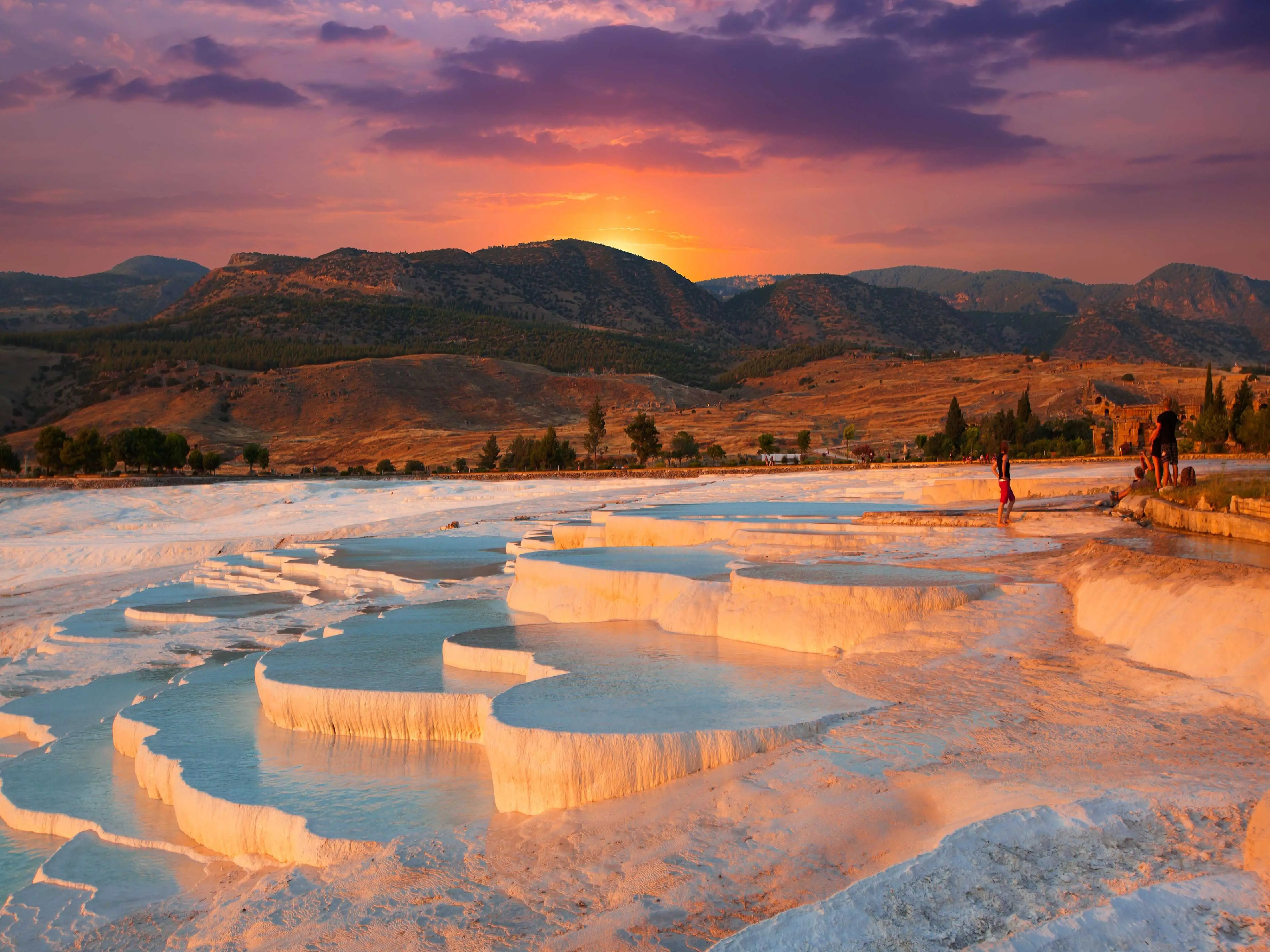The naturally terraced thermal springs of Hierapolis-Pamukkale in the province of Denizli in western Turkey, date as far back as the second century B.C. Formed by calcite in the water, the hot springs look like stunning white clouds.