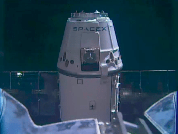 SpaceXs Dragon capsule docks with the space station